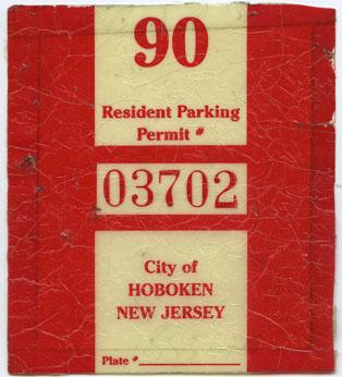 A 1990 parking sticker. Gift in memory of Helen Nitschke by Laurette Whittle.