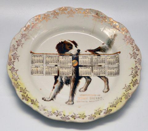 1910 calendar plate. Gift of Beverly Matthews.